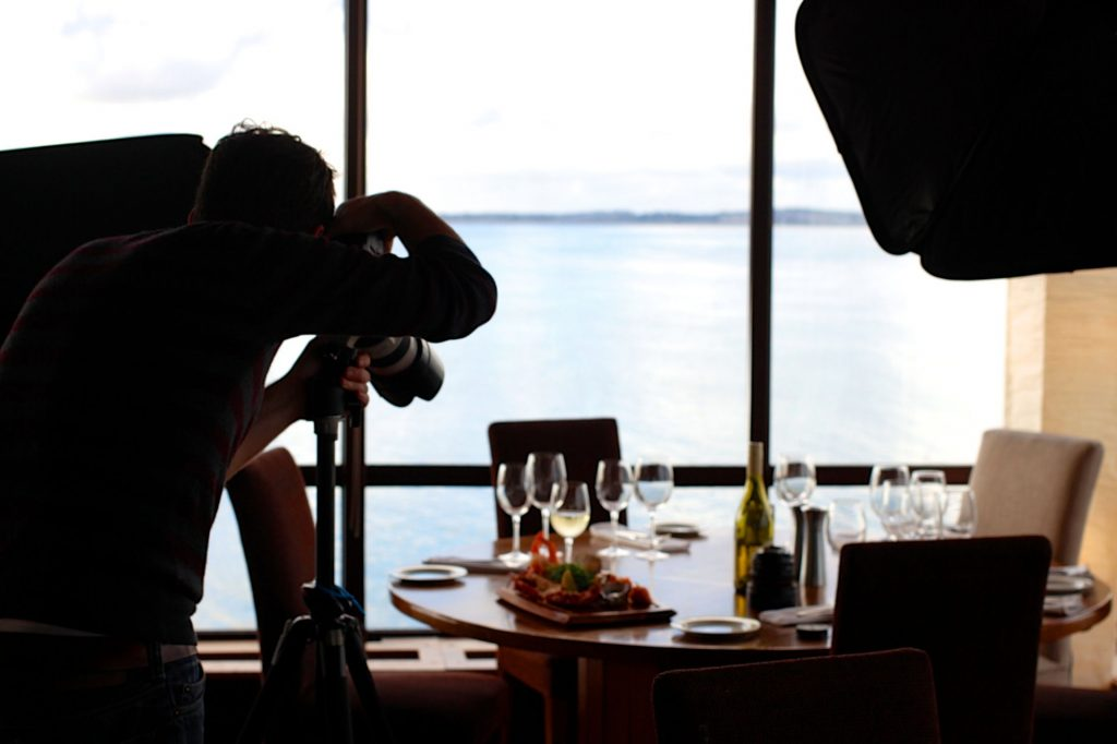 Photographer taking picture of restaurant table